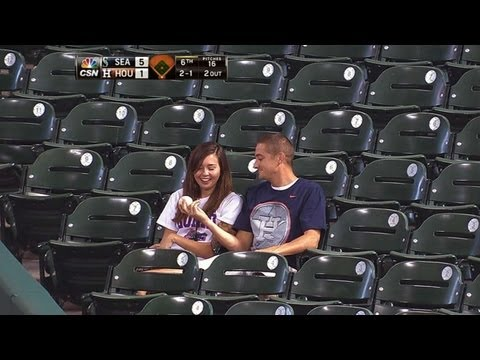 Fan makes catch to save girlfriend from foul