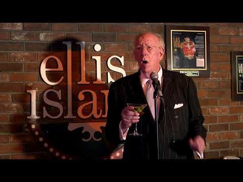 Sing for Strength: Oscar Goodman karaokes at Ellis Island