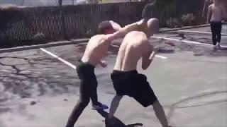 Brutal slam on concrete in a street fight