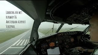 Holding at RIVER and landing at wet runway 06 Amsterdam Airport Schiphol (AMS EHAM).