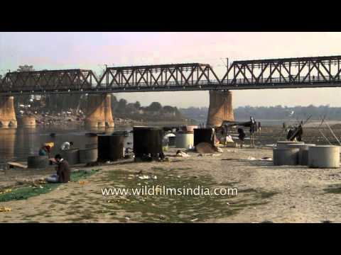 Open air laundry: Clothes washed and dried on Yamuna River bank, Agra