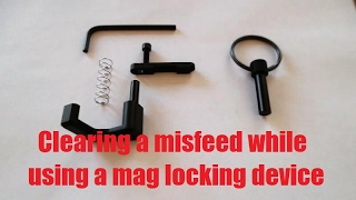 clearing a misfeed while using a mag lock device