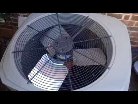 Central Air Conditioner Fan Blades Spinning On A Windy