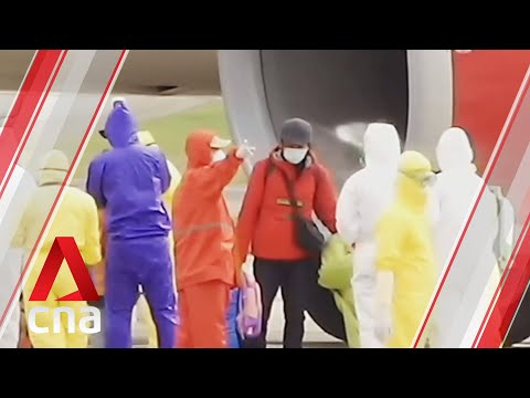 Indonesia sprays passengers with disinfectant on return from Wuhan