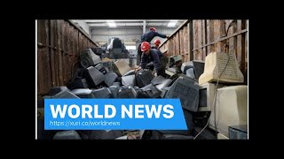 World News - China town trash cleanup supported by import ban
