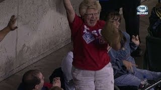 Woman makes a crazy catch on screaming liner