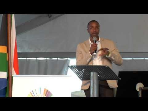 Mhlengi Denza speaks at the Jacob G Zuma RDP Education Trust Christmas Party