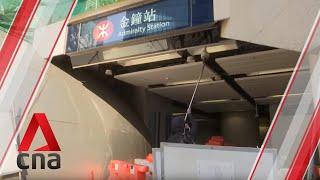 Hong Kong protesters block station and smash cameras at Admiralty MTR