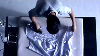 GarraStyle - Man ironing a shirt