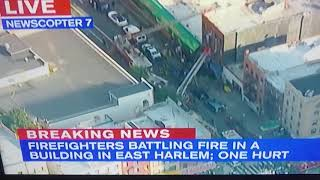 Firefighters battling fire in a building in East Harlem one hurt