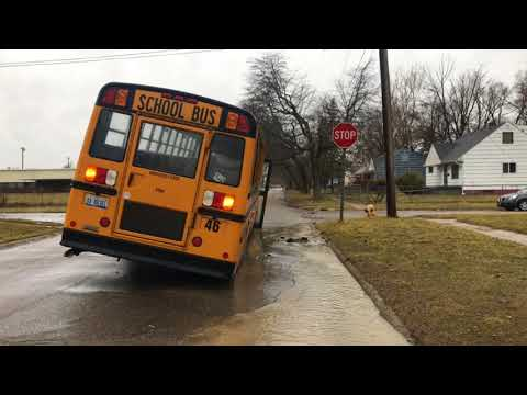 Flint school bus stuck due to flooding