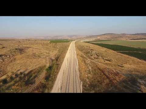 Flying above the tracks of A1 rapid train to Jerusalem