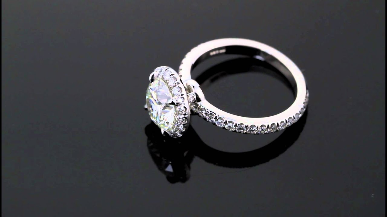 1 51 Carat Brilliant Round Diamond set in Micro Pave Halo Engagement Ring by