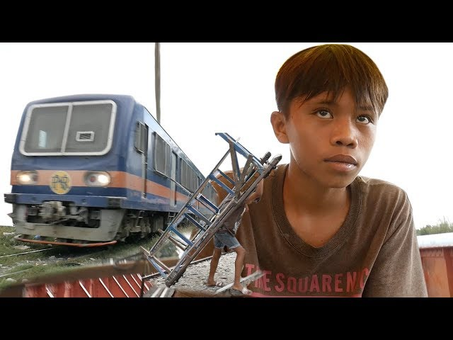 Meet The Manila Trolley Boys... Risking Their Lives On The Philippines' Train Tracks
