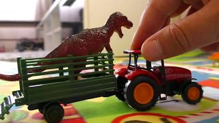 TOY TRACTOR TRANSPORTATION OF DINOSAURS