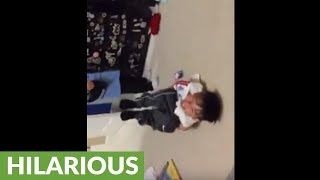 Dad pranks his kids with awesome blanket scare