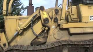 Caterpillar 955L crawler loader & Raygo Rascal roller