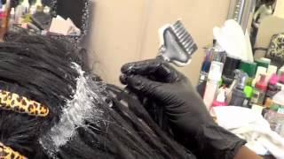 Relaxing African American Hair While Wearing Fusion Hair Extensions at Noelle Salon