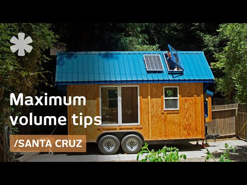 Tiny home packs storage stairs, 2 lofts, tub in 136 sq ft - YouTube