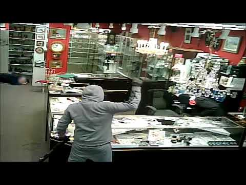 CCTV Armed Robbery at Heirlooms Antiques Calgary