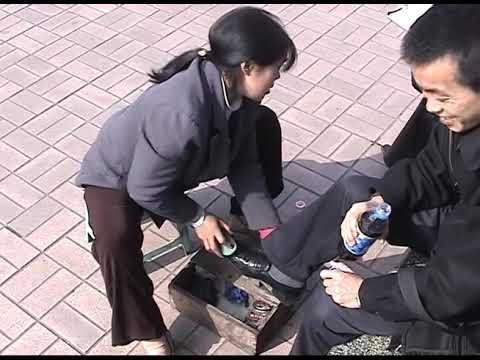 A shoeshine girl at the Chongqing Yangtze river port in 2002