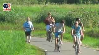 Getting dressed while riding a bicycle (Netherlands)