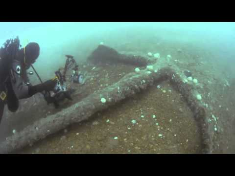 Large anchor on sea bed