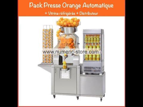 Presse Orange Automatique en action / Commercial Orange juicer