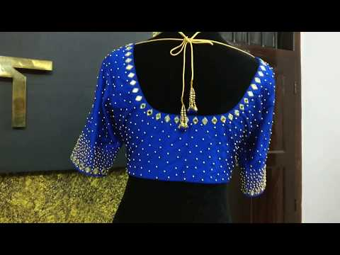 Thick beadwork blouse with mirror on neckline