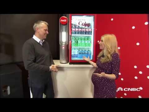 Coca-Cola CEO James Quincey demos the new Arctic Coke cooler