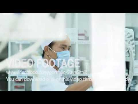 Asian man working in the medical laboratory. Dialysis machine. Video stock footage