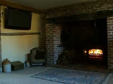 Wood burning stove in Inglenook Fireplace. Oct 2011