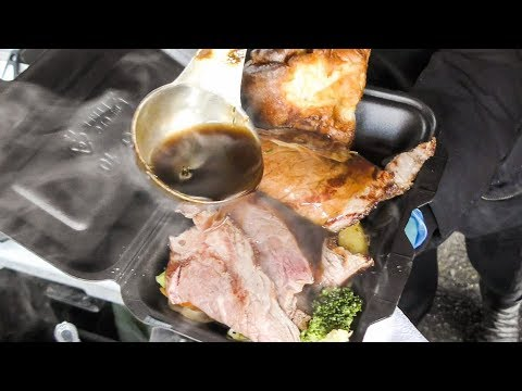 British Sunday Roast of Beef Cooked and Tasted in London. Street Food of Brick Lane