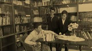 At the library. ALEX, HASSAN, TIAGO