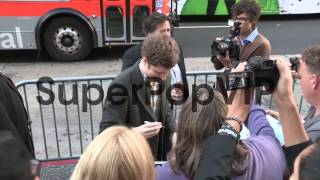 Michael Cera greets fans while arriving at the Arrested D...