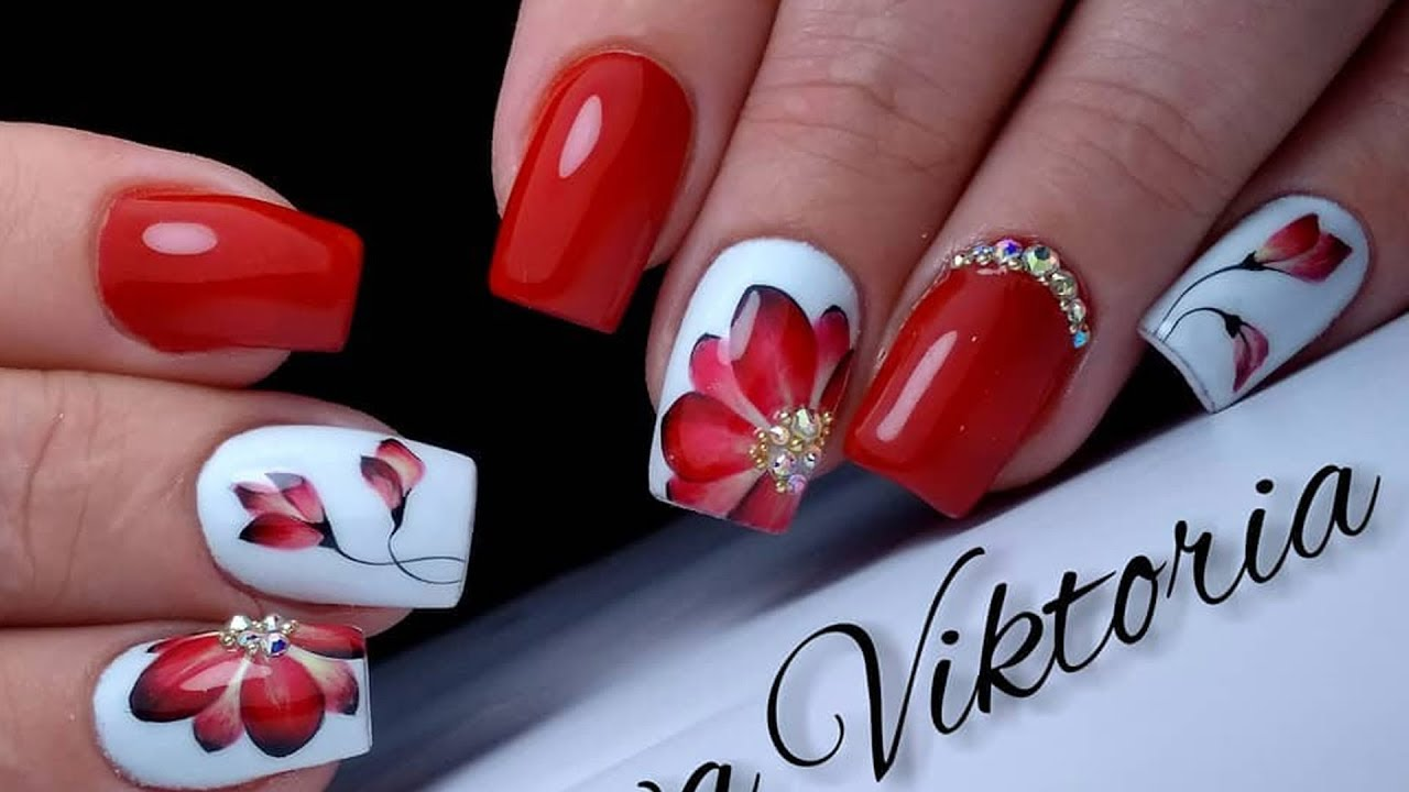 Beautiful and simple design of red flower nails. TOP Surprising Nails  Designs