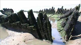 Teenage Beach Girls Explore 19th.C Shipwreck uncovered by tide.