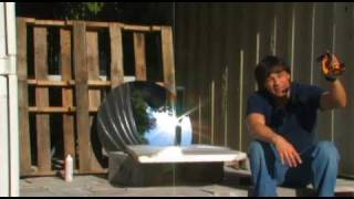 PARABOLIC MIRROR concentrated sunlight on an evacuated solar tube boiling water with the Sun