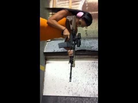 Kristen DeLuca shooting an AR15