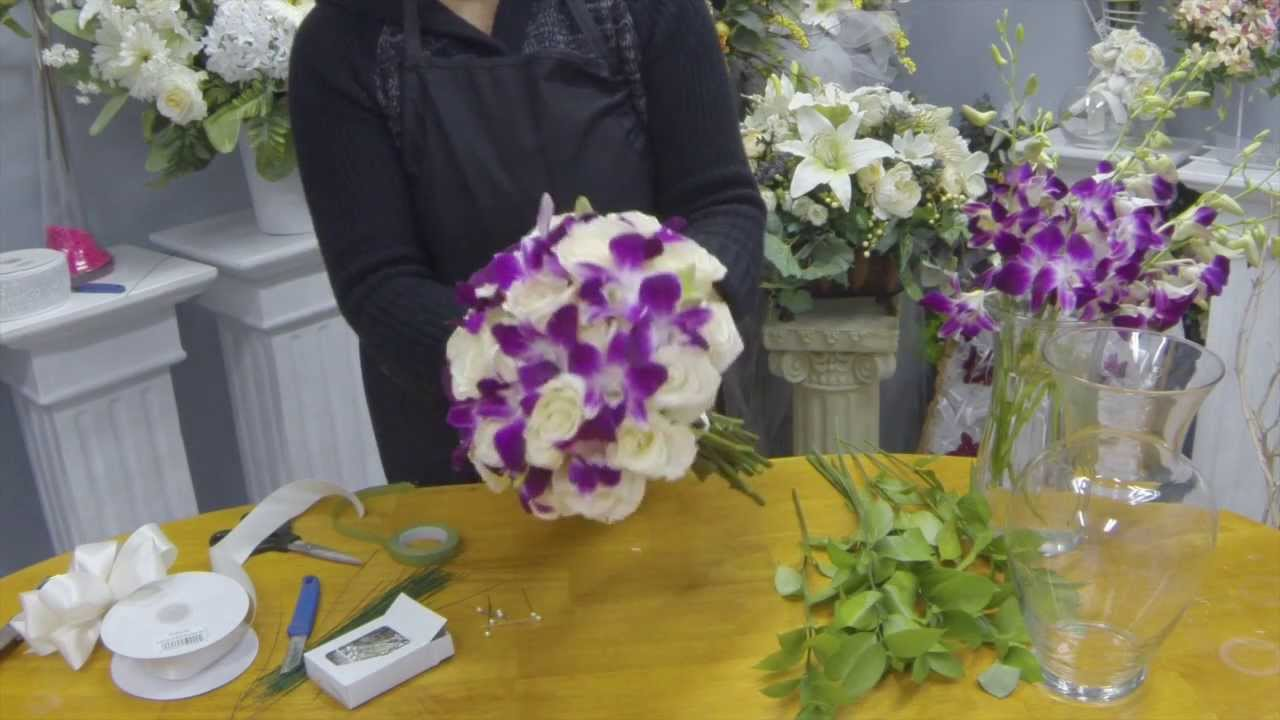 How to make a hand tied bridal bouquet with roses and dendrobium how to make a hand tied bridal bouquet with roses and dendrobium orchids youtube izmirmasajfo