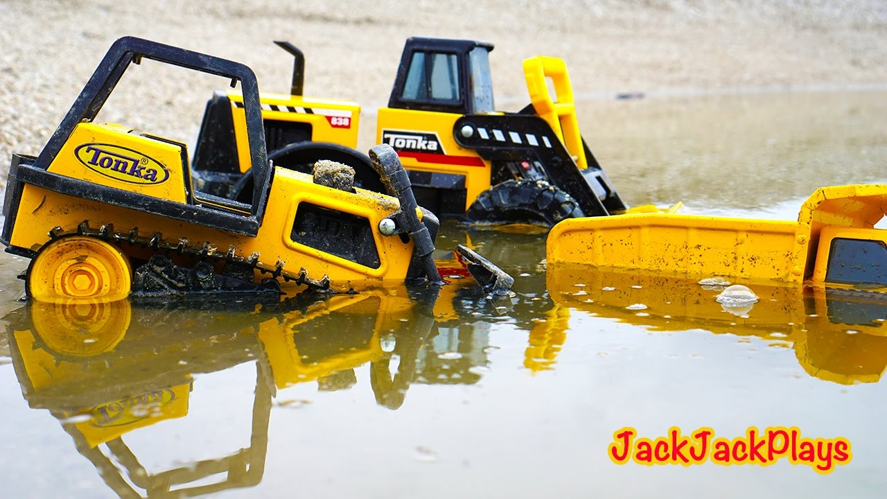 Toy Construction Trucks : Tonka toy construction trucks working in mud kid playing
