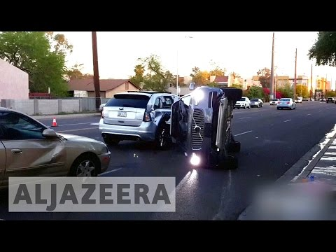 Uber suspends driverless cars after crash