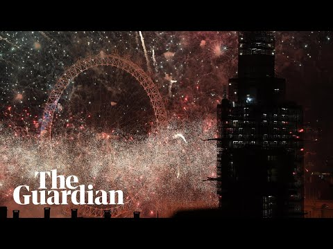 London's Big Ben rings in the new year and fireworks light up the sky