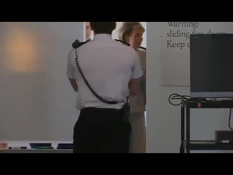 Michaelia Cash hides from the media behind a whiteboard