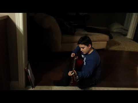 Luca G playing his guitar 2018