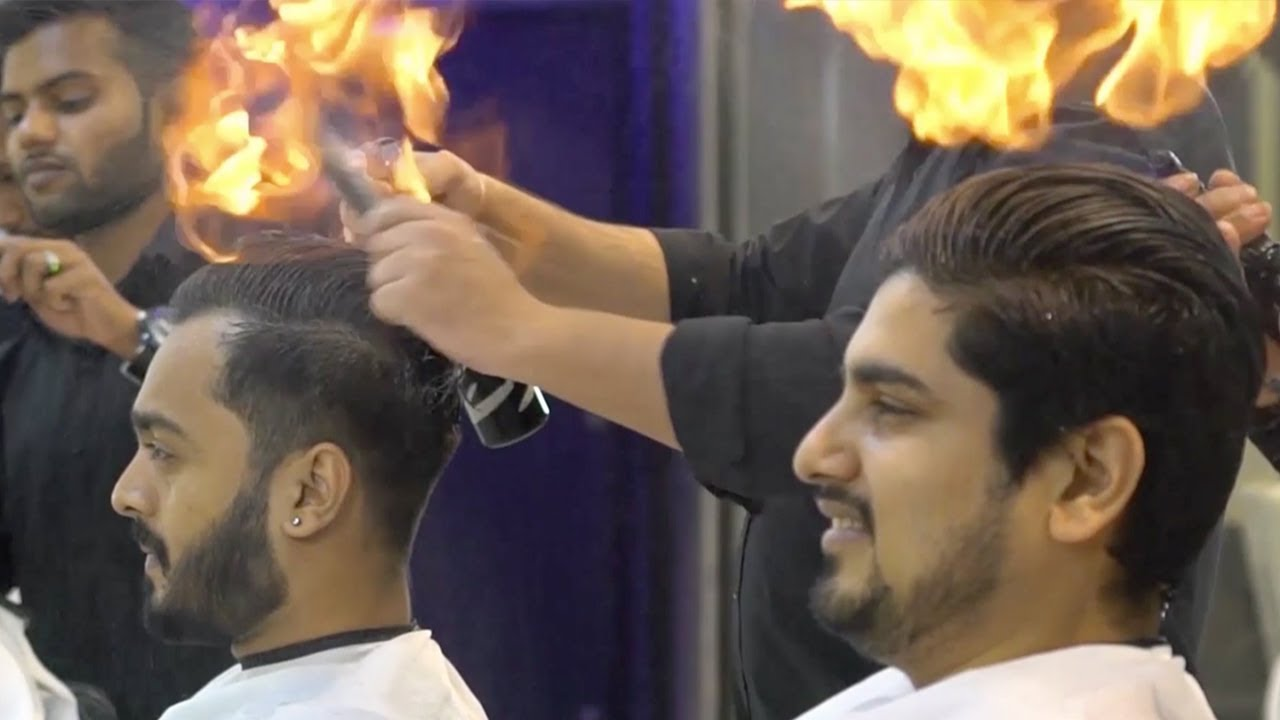 indian barber cuts men's hair by setting it on fire