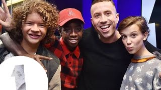 The cast of Stranger Things with Grimmy