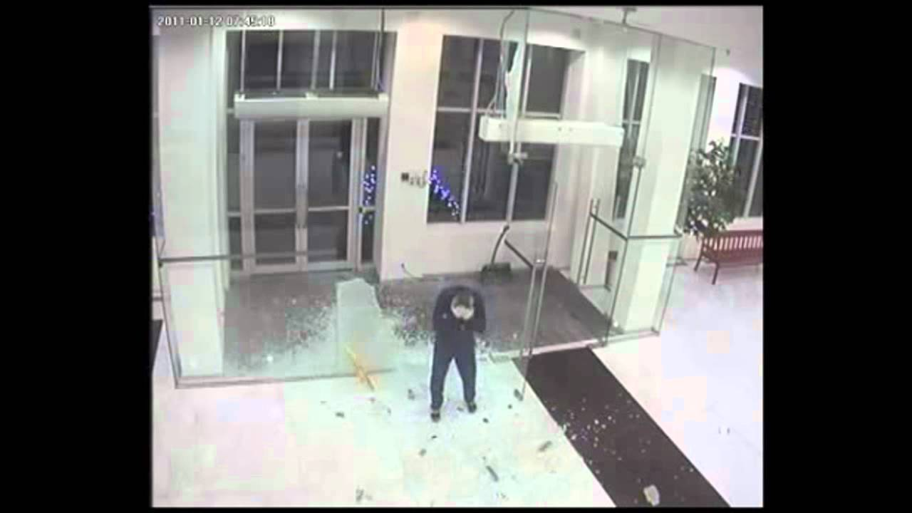 Man Shatters Glass Door