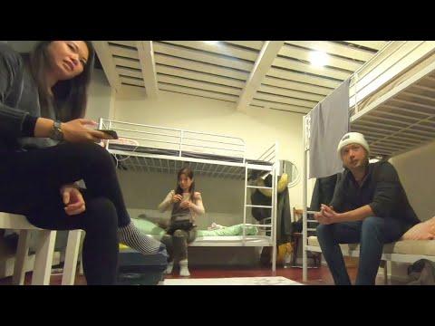 World Travelers Talking in a Hostel
