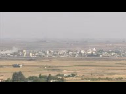 Smoke over Syria town 'seized' by Turkey military